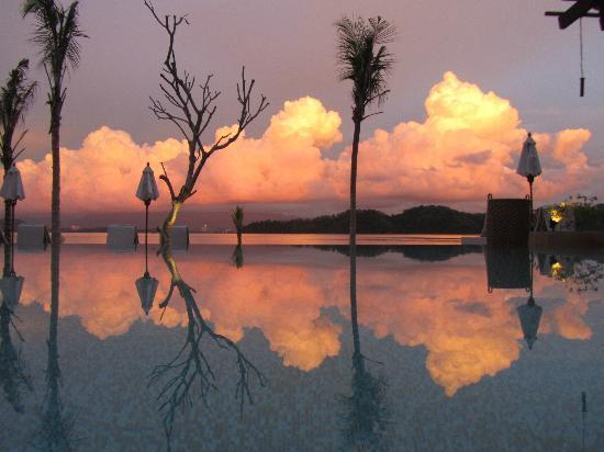 Gaya Island Resort: View from pool lounger of reflected sunset (looking east)