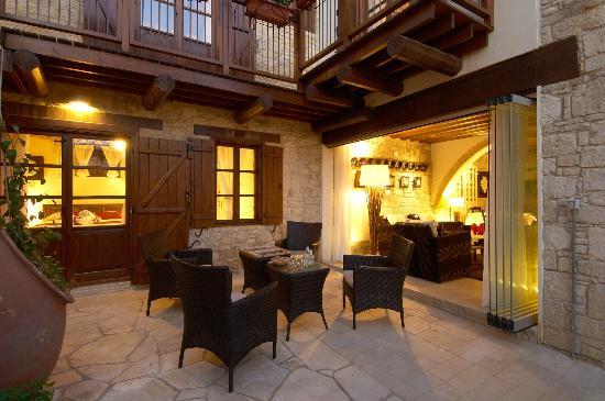 Arsorama Village Homes: Communal sitting room and garden