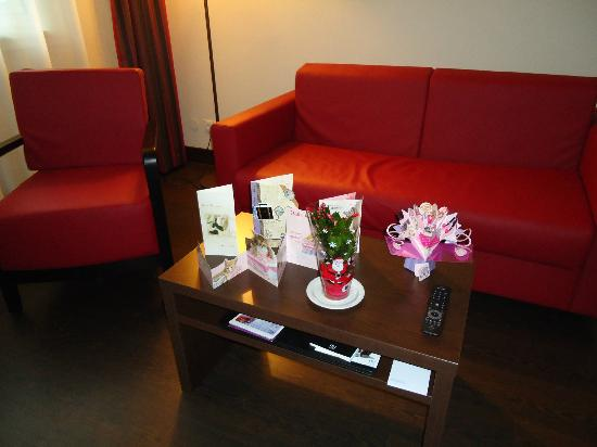 NH Wien City: Living room (the flower and card are mine :), not from hotel )