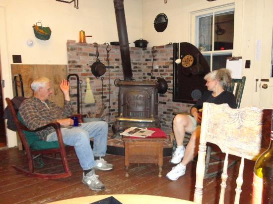 Hopkins House Farm Bed & Breakfast: Charlie and Aggie built the surround for the wood stove