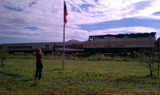 Railside RV Ranch: Waving as the Grand Canyon Railroad train passes.
