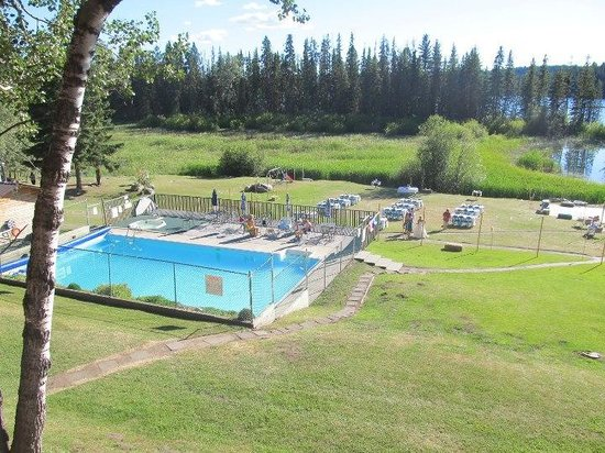 Roche Lake Resort :                   view of pool and lake from our chalet (3A)