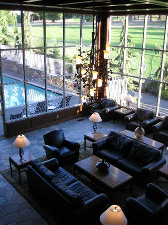 Olympic Lodge: lobby with pool to the side and golf course behind