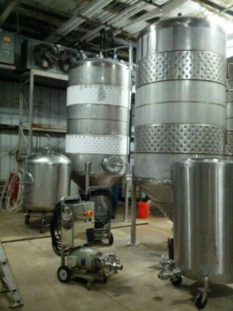 New Holland Brewing Company: Later stage where the beer is kept to a consistent temp. The tank on the left is white because i