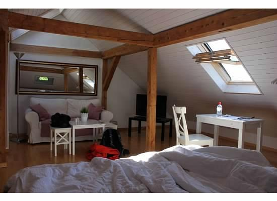The Bed and Breakfast: The cozy attic room