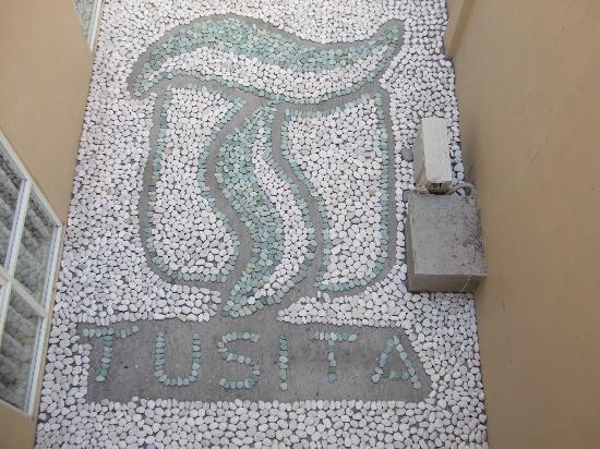 The Tusita Hotel: Stone insignia