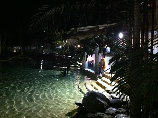 Ramada Resort Port Douglas: pool area at night/ swim up bar area