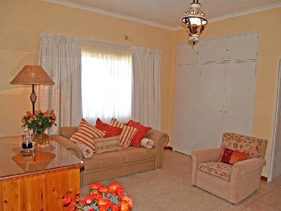 A Tuscan Villa Guest House : Kalk Bay Family Suite Lounge showing Queen size sleeper couch