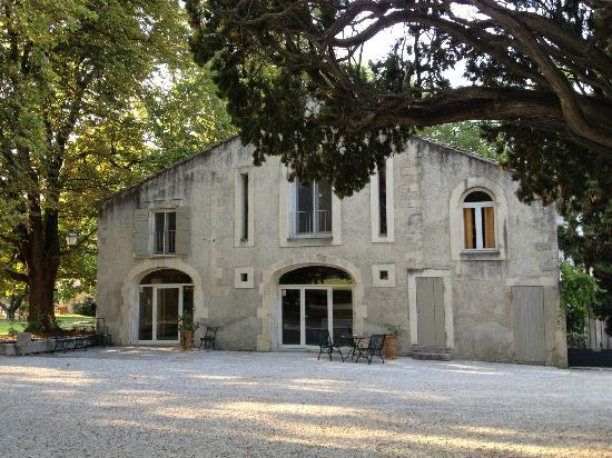 "Le Chateau des Alpilles: The entry to the ""apartment"" is the door on the right."