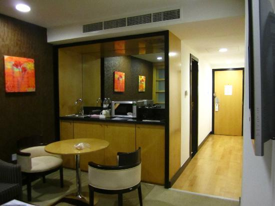 Savoy Suites Hotel Apartments: view of mini kitchen + toilet door on the left + room door