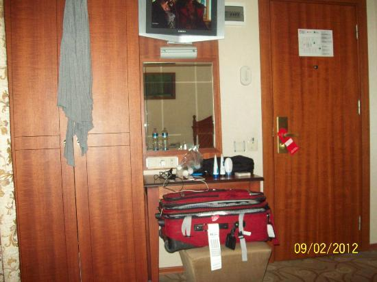 Lady Diana Hotel: View of mounted TV and vanity. A/C was above the closet.