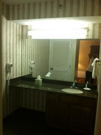 Chase Suite Hotel- Tampa: Bathroom Area- Toilet and Shower through door to your right.