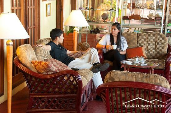 Grand Coastal Hotel: Sip coffee and read the papers in our cozy lounge areas.