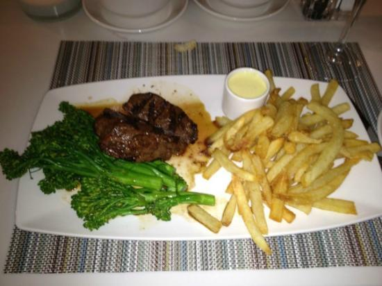 Solaire Restaurant + Bar: Sirloin Steak (I took the picture after I had cut my steak, perfectly juicy!)