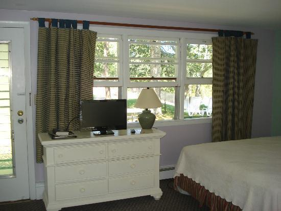 CapeWind Waterfront Resort: taken from main room in suite, looking out on to the grounds