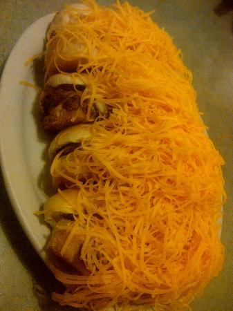 Skyline Chili: 4 individual Cheese Coneys - buried under a mountain of cheese :)