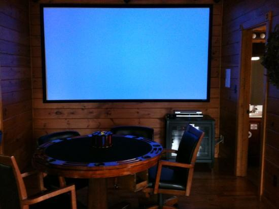 Gatlinburg Falls Resort: theatre screen with game table .. not pictured is air hockey, multi game system, golden Tee and