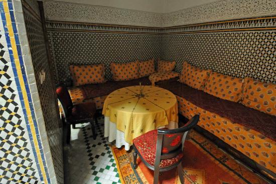 Riad Dar Dmana: One of the little side nooks for dining. very romantic.