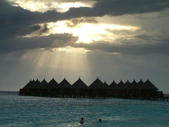 Angaga Island Resort & Spa: sun setting over water villas