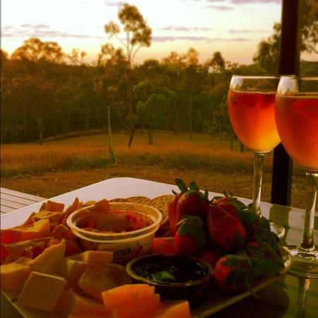 Barking Owl Retreat: local produce, strawberries and cheese looking out to the bush