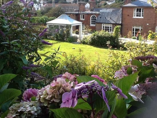The Old Rectory: looking out over terrace from upper garden