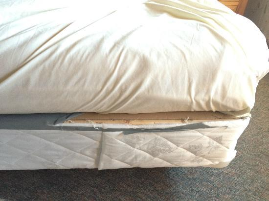 Island Inn: Bbattered box spring flipped over to live another day