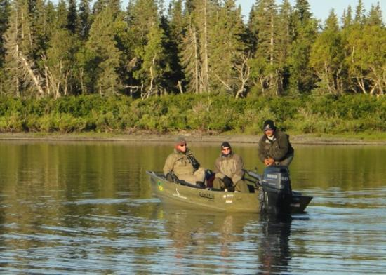 Alaska's Bearclaw Lodge: Guests and guide prepare for fishing on Wood River for silver salmon.