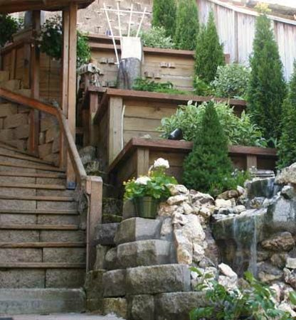 Beachside Villa Luxury Inn: garden waterfall