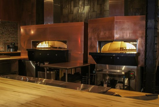 Chimayo Stone Fired Kitchen : Our twin stone fired ovens in the open kitchen