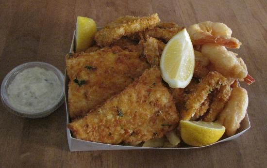 Chipper Fish: Melt-in-the mouth fish, prawns and calimari presented in a light crispy herbed crumbed batter.