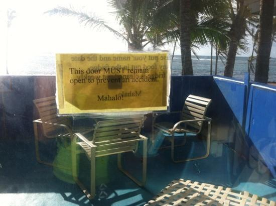 "Kauai Beach House: ""door must remain open to prevent accident"" on sliding door to patio. funny"