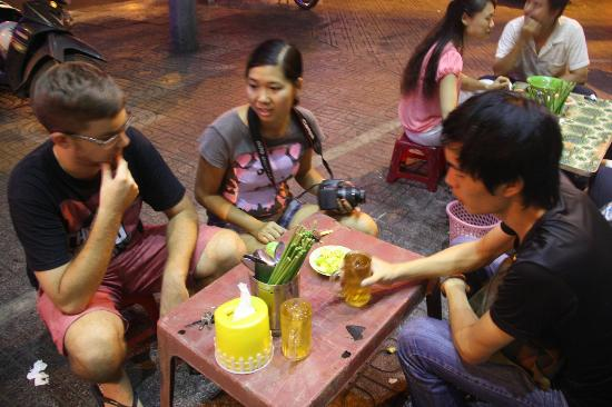 Tur Harian - Back of the Bike Tours: by the roadside for spicy noodle in fermented soup