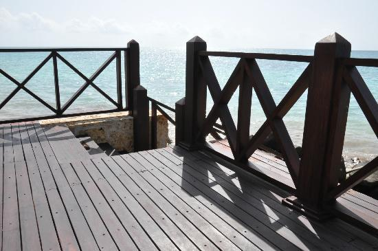 Sanctuary Cap Cana by AlSol: Steps going down to ocean on the Royal Villa deck.