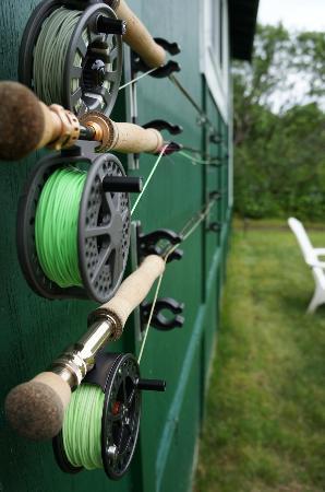 Saltery Lake Lodge: Our fly fishing rods on our cabin wall