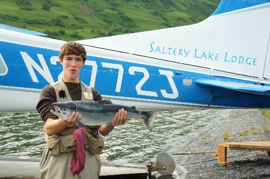My son with Red salmon and the Saltery Lake Lodge plane