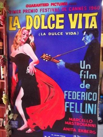 Fellini's Pizzeria: The slogen of the restaurant.