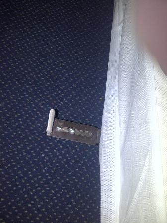 Days Inn Muskogee: part of bed frame, foot and trip hazard