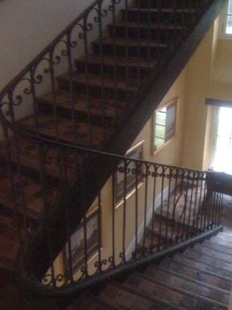 Chateau de Saint Maclou la Campagne: Art-lined staircase to first floor