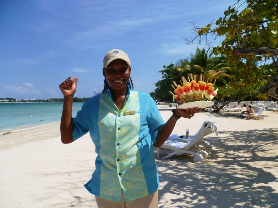 Couples Negril: Mesha delivering melon kebabs to cool us