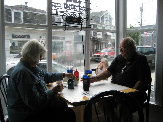 Mom and Dad in the window of the Harbor Cafe