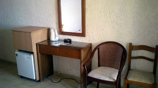 Maria Anna Hotel: The dresssing table, fridge and cabinet in the room