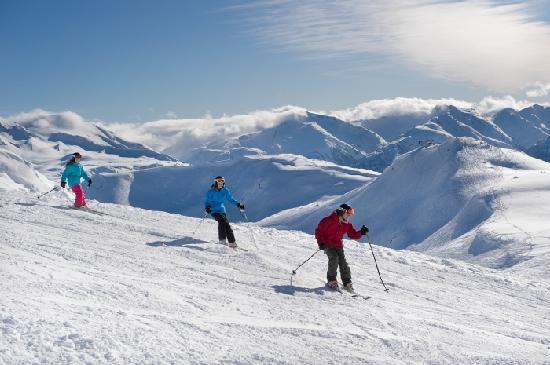 Family Enjoys A Ski Day On Whistler Mountain Blue Bird Photo Credit