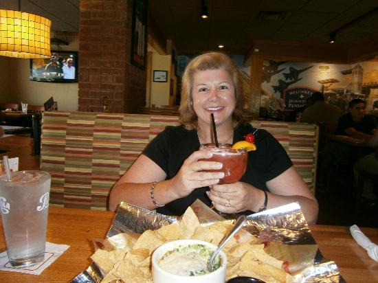 Applebee's: Pat enjoying a Hurricane and a appetizer before dinner.