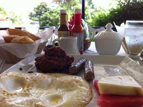 Running W Steakhouse & Restaurant: belizean original breakfast with fried jacks, sausages, over medium eggs, fruits!