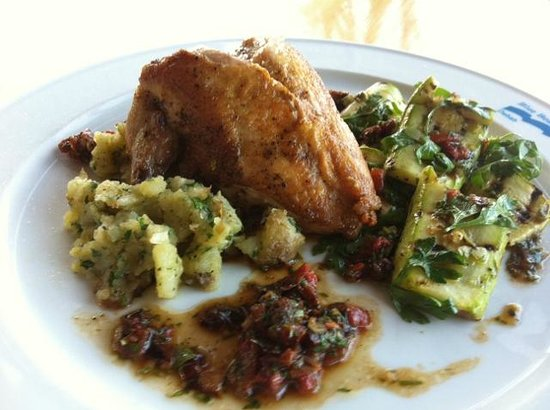 Essence Brasserie: Roast chicken breasts, grilled courgette & herb salad with crushed herb potatoes, tomaato & basi