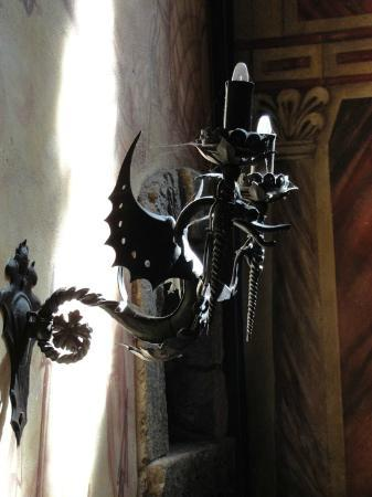 Castello di Amorosa: Iron dragon candles