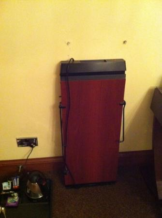 Glenbervie House Hotel: trouser press on floor with screws above