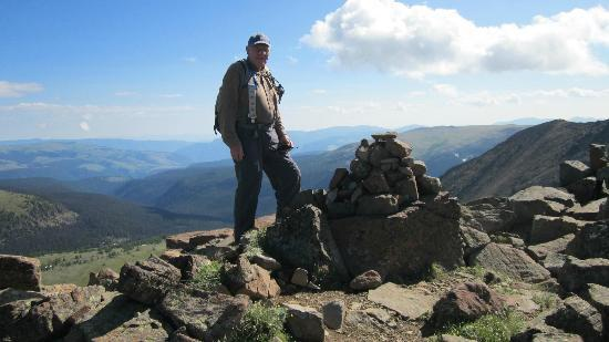 Cathedral Lakes Lodge: Jim on top of one of the peaks