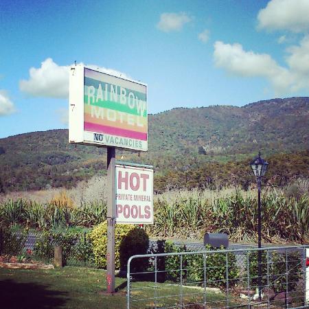 Rainbow motel road sign