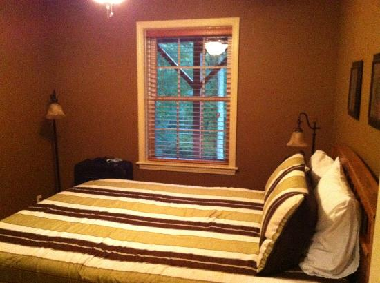 Asheville Cottages: the smaller bedroom, with Queen bed & wooded view